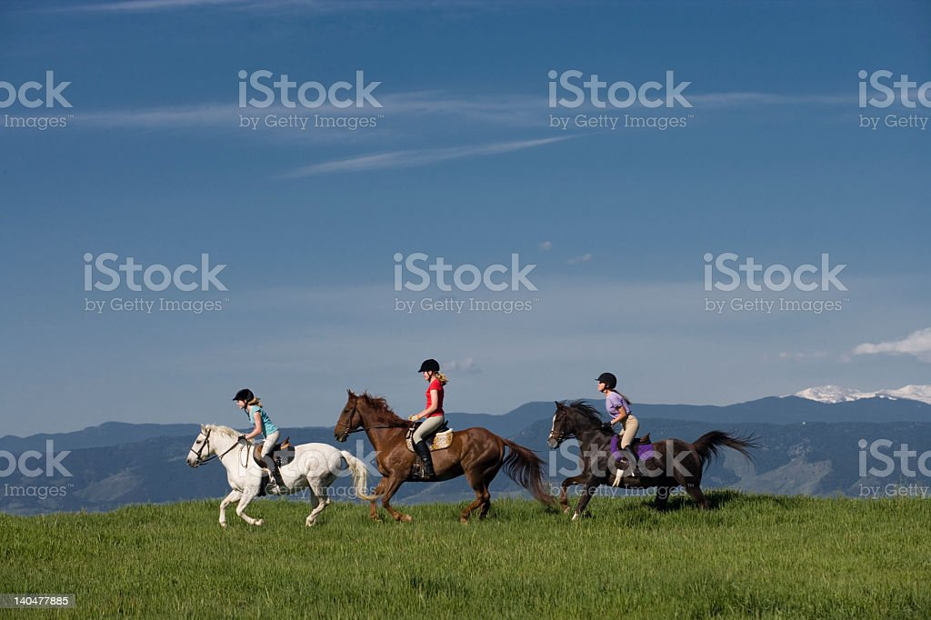 Running on horseback stock photo