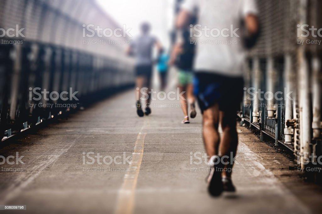 Running on Manhattan Bridge in New York City stock photo