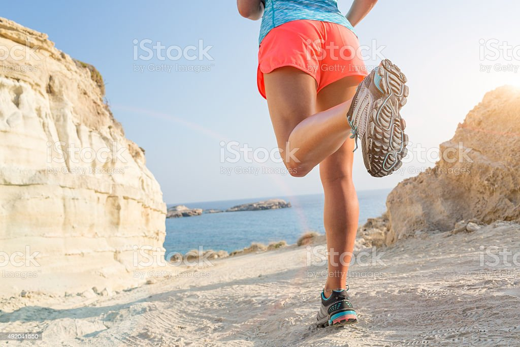 Running on seaside path. stock photo