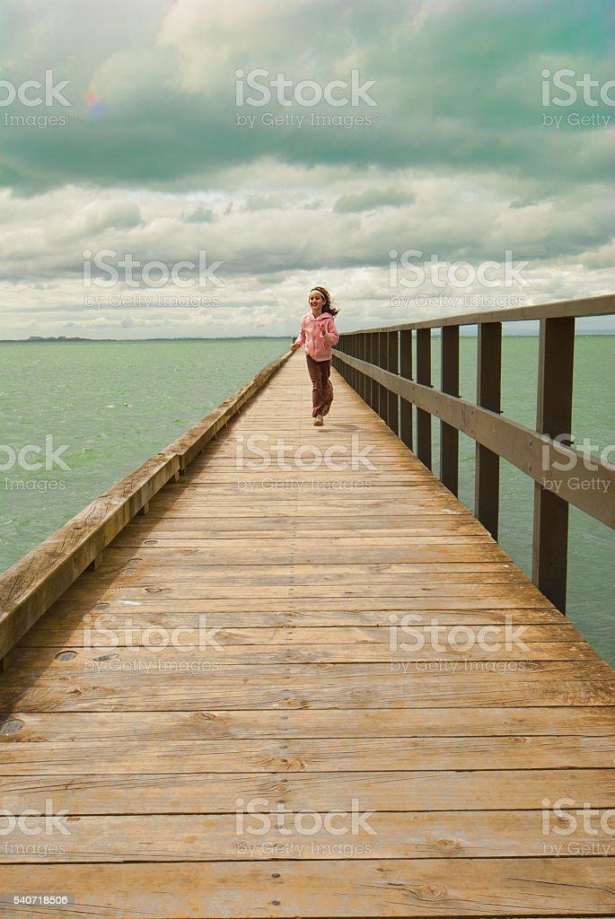 Running on the pier stock photo