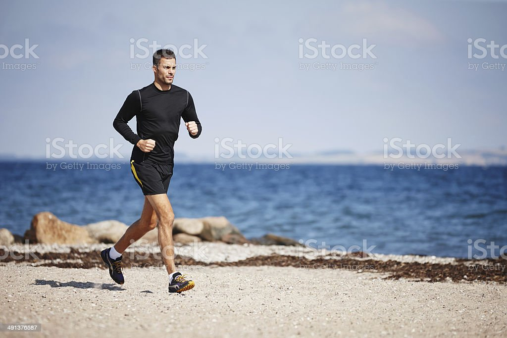 Running on the sand is a great workout stock photo