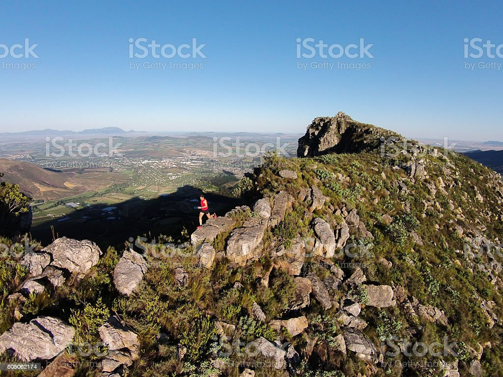 Running on top of the mountain stock photo
