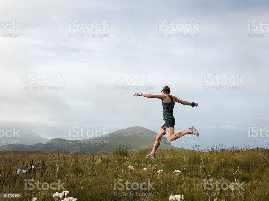 Running on top of the world stock photo