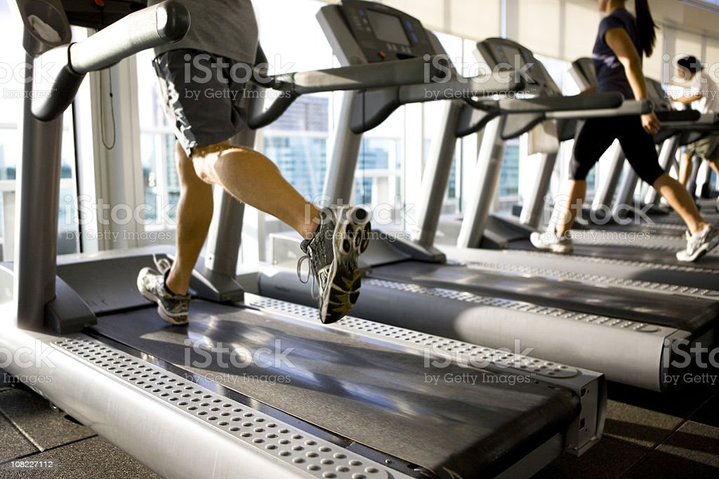 Running on treadmill in gym royalty-free stock photo