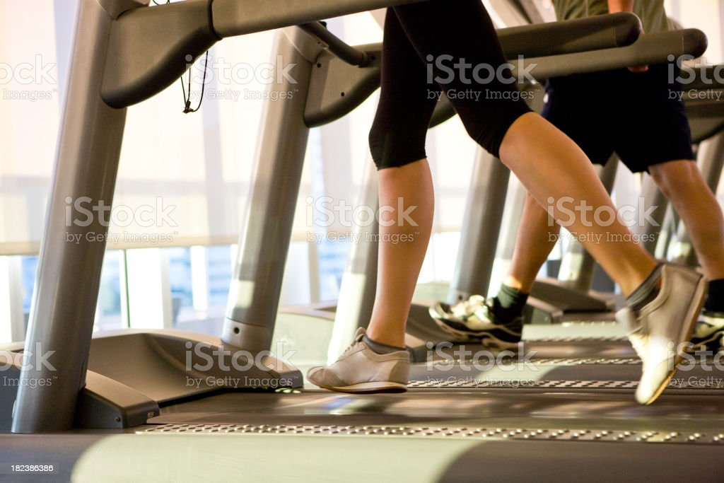 Running on treadmill royalty-free stock photo