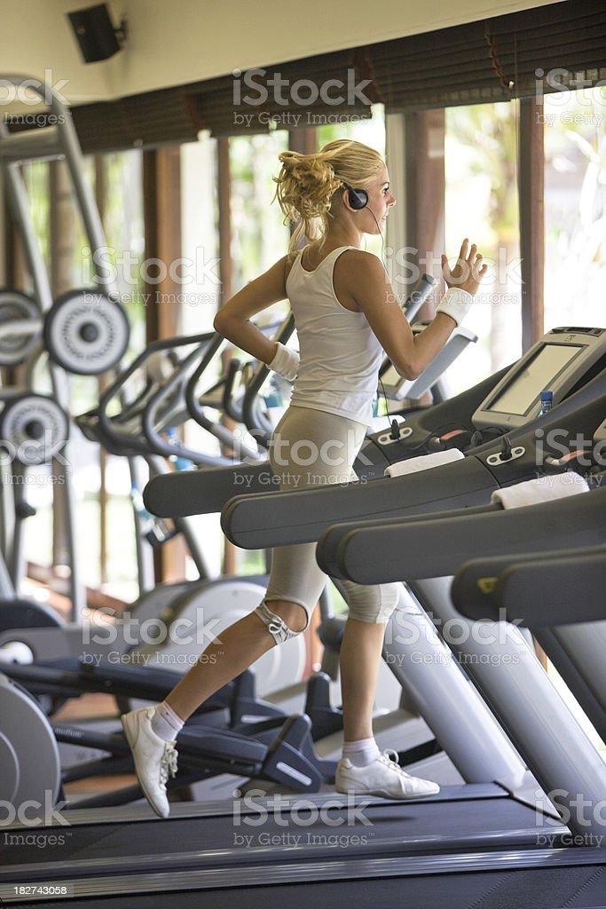 Running on treadmill royalty-free stock photo