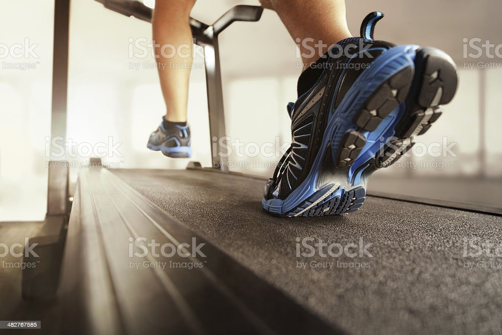 Running on treadmill stock photo