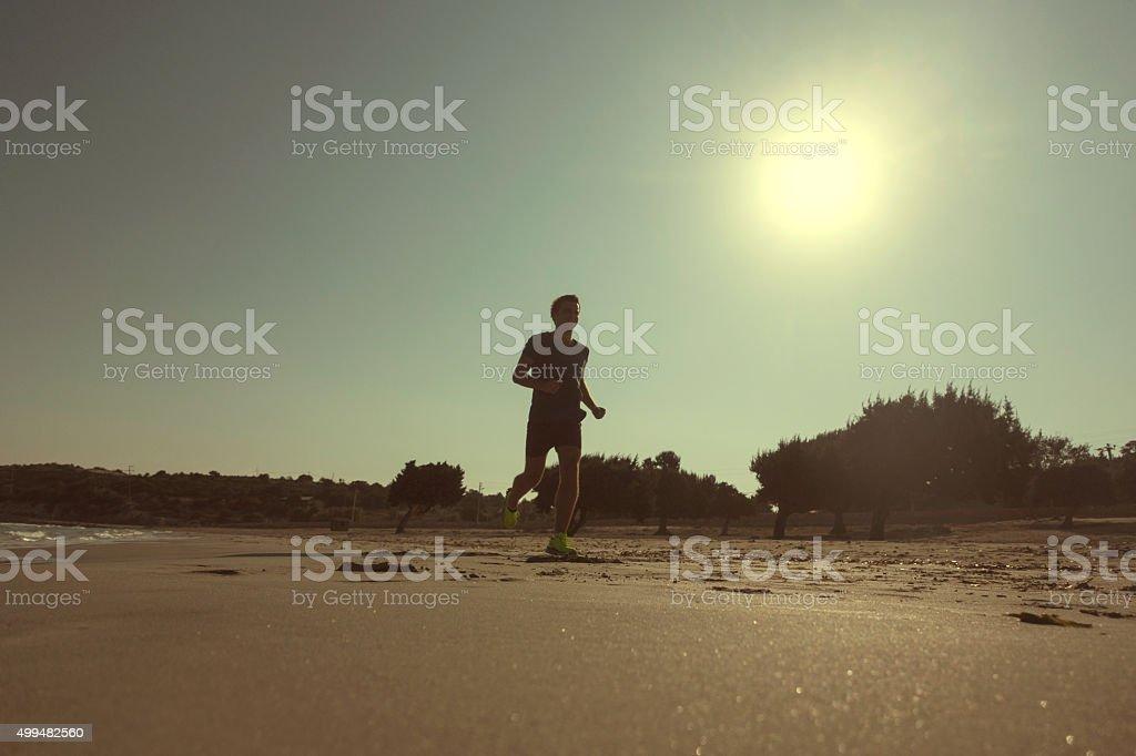 running outdoor on seaside sands stock photo