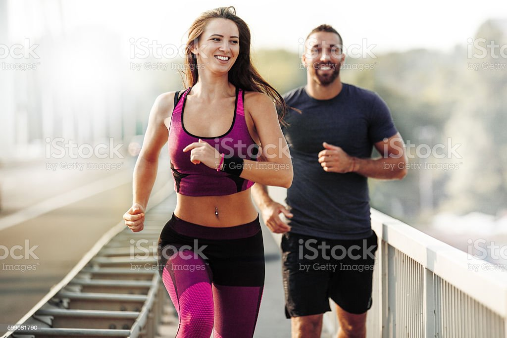 Running Outdoors. Sport, Health and Fitness. stock photo
