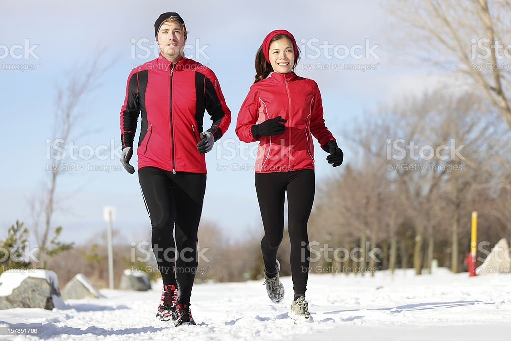 Running. Runners exercising in winter royalty-free stock photo