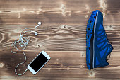 Running Shoe with phone & earphones on table