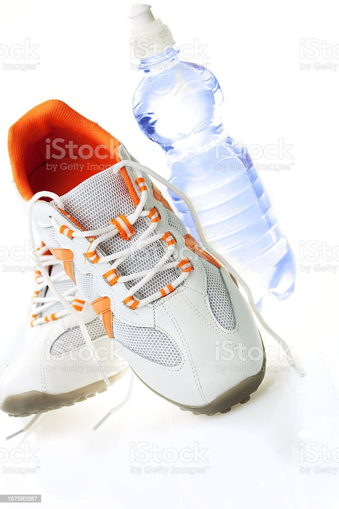 Running shoes and fresh water royalty-free stock photo