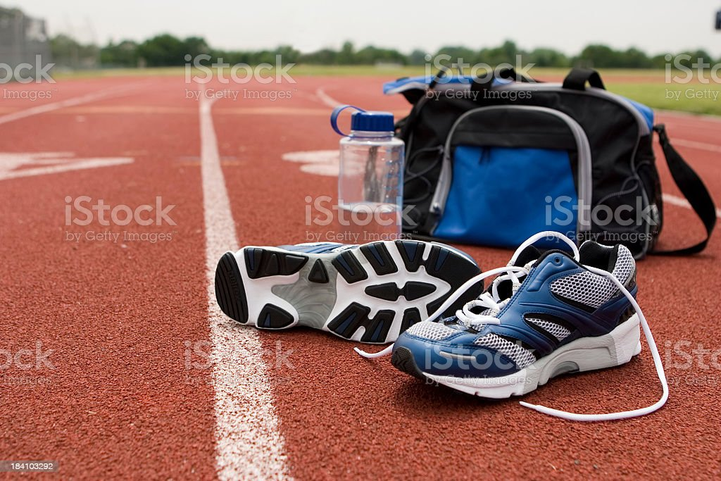 Running Shoes & Bag on Track II royalty-free stock photo