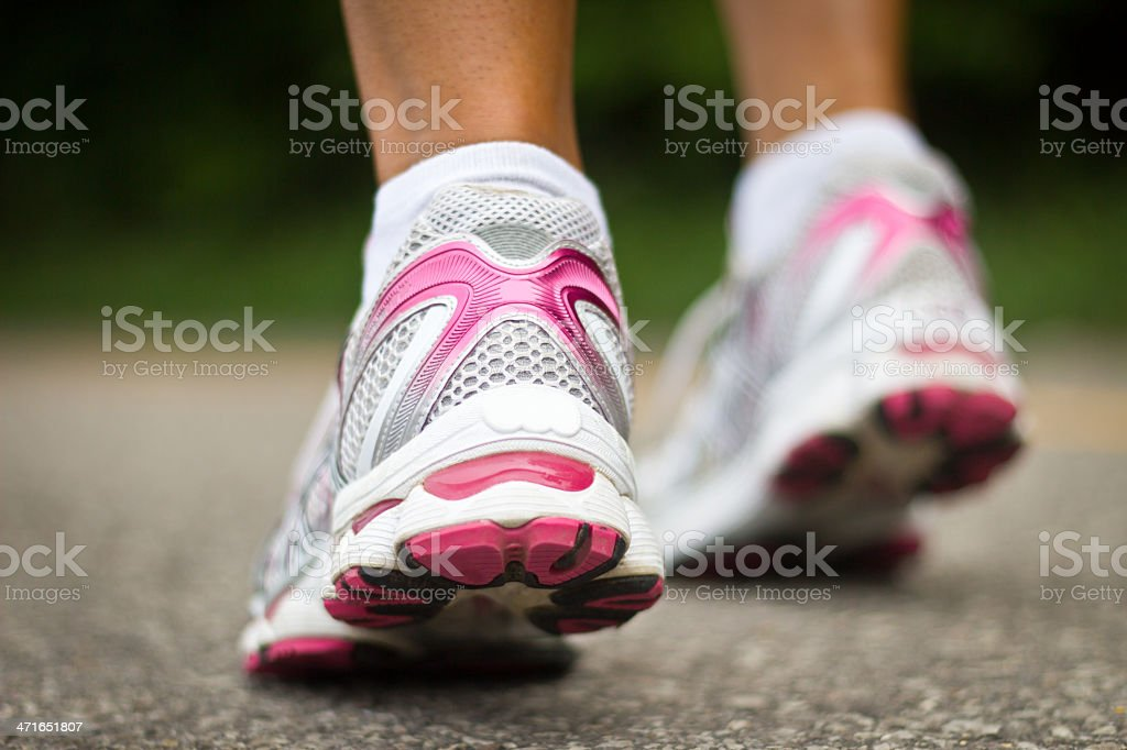 Running shoes close-up of a female runner. royalty-free stock photo