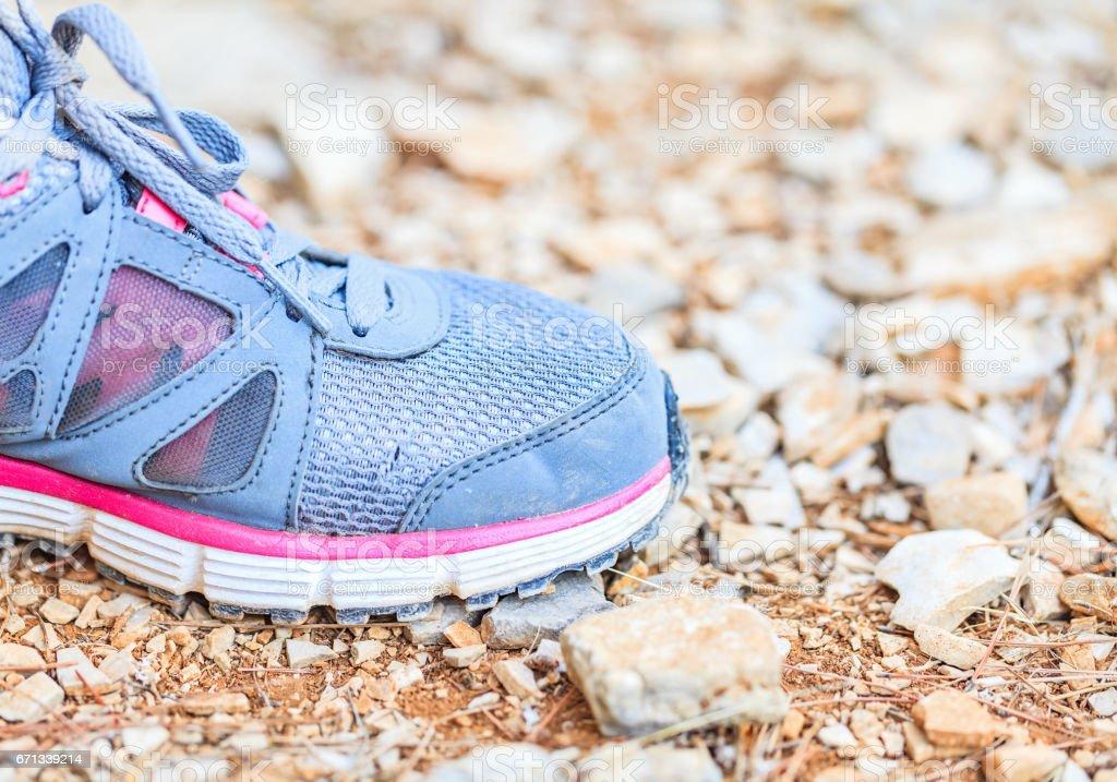 Running shoes on stony ground stock photo