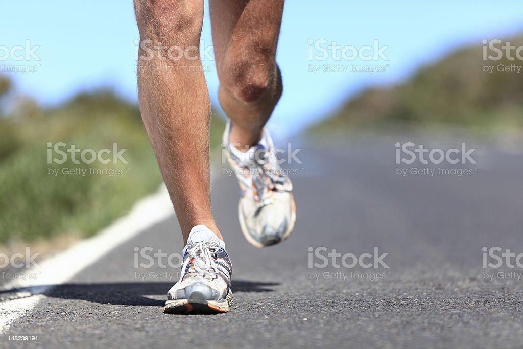 Running shoes - runner legs closeup royalty-free stock photo