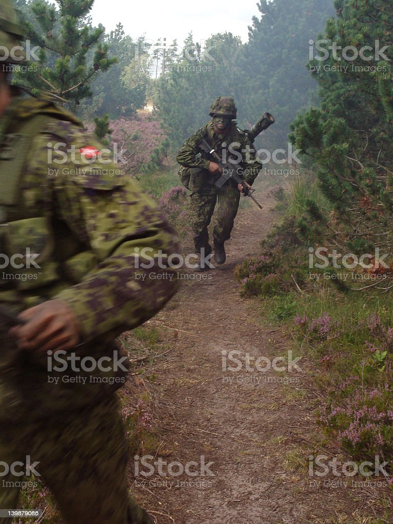 Running soldier with soft focus and motion blur. stock photo