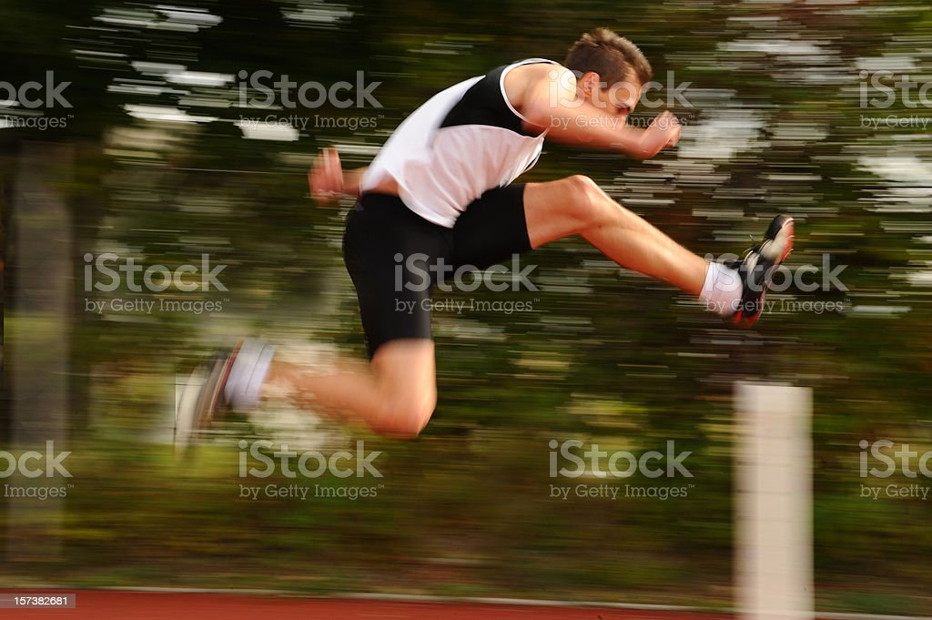 Running the hurdle royalty-free stock photo