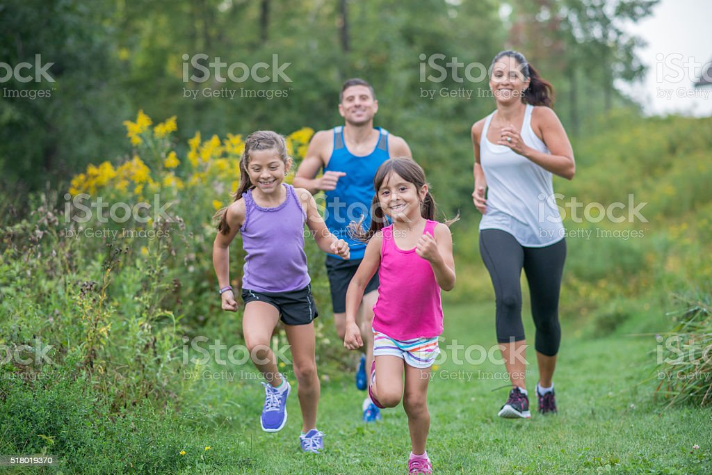 Running Through a Grassy Field stock photo