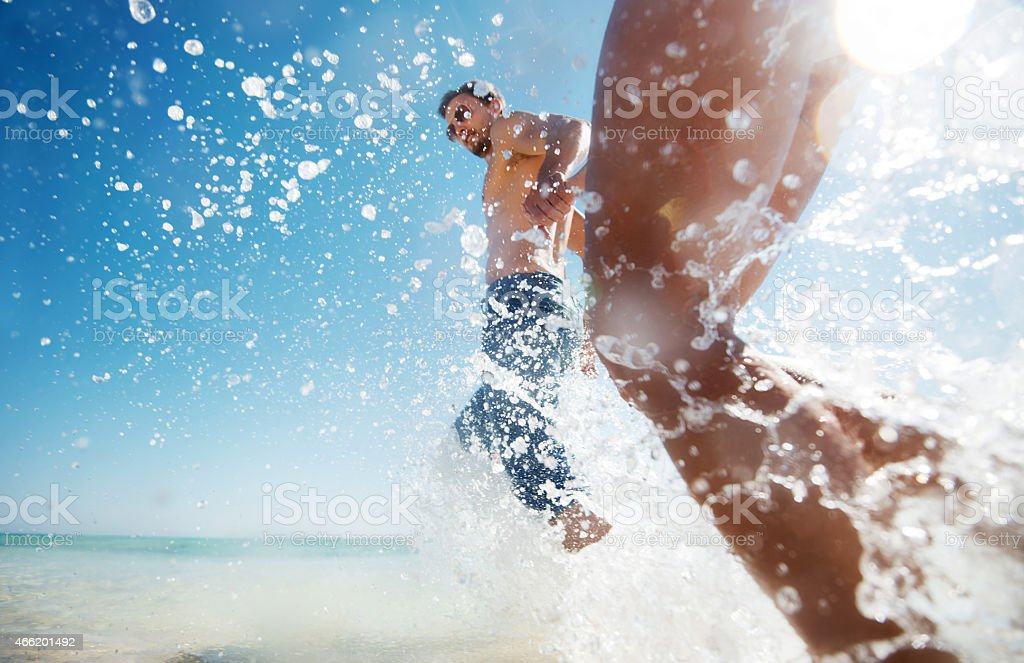 Running through sea in summer day. stock photo