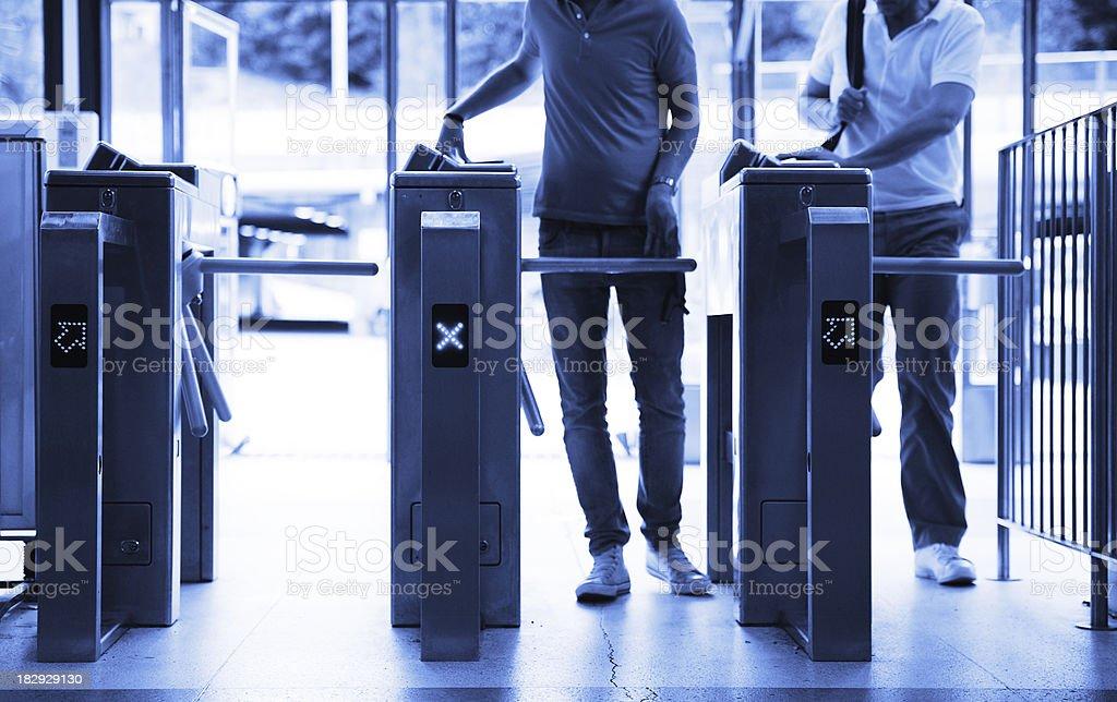 Running through subway gates stock photo
