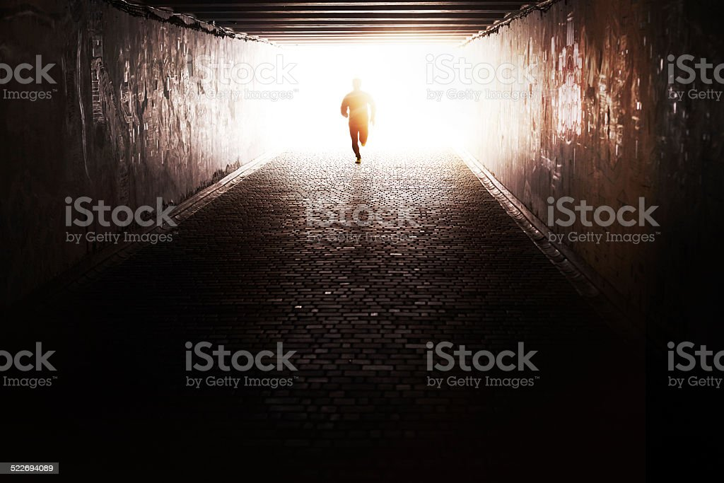 Running through the tunnel stock photo