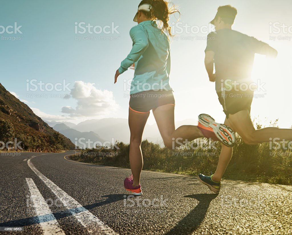Running to escape the ordinary stock photo