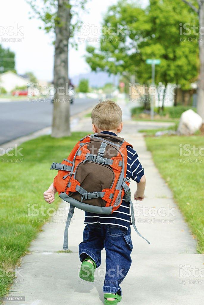 running to school stock photo