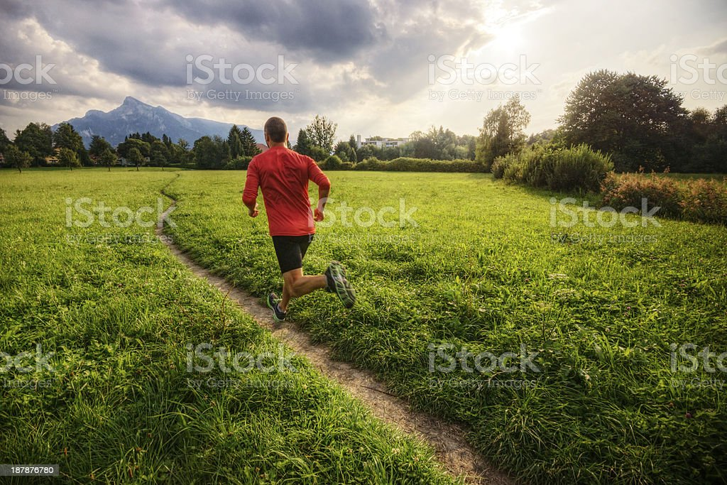 Running to the Mountains at Sunset stock photo
