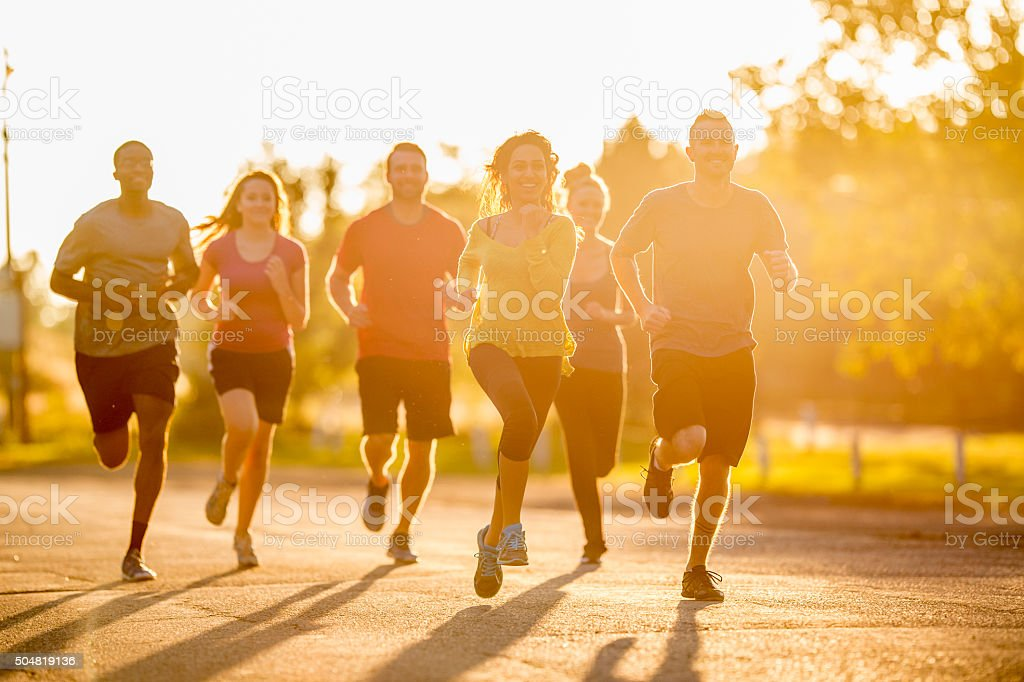 Running Together at Dusk stock photo