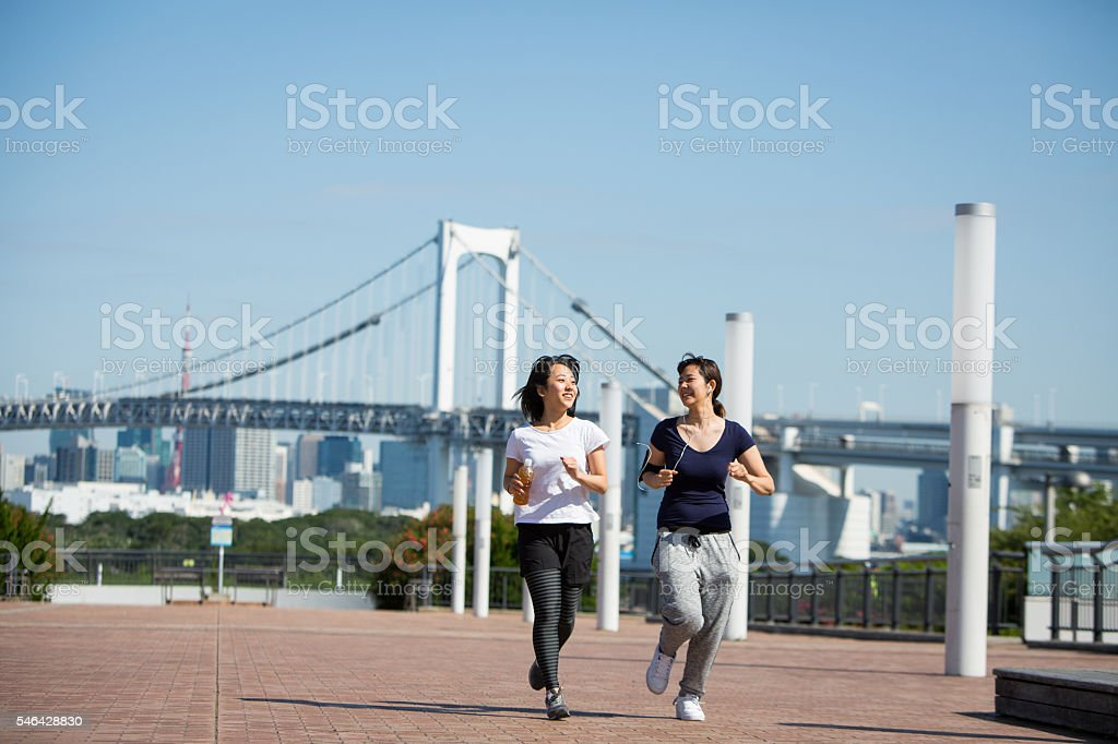 Running together early morning stock photo