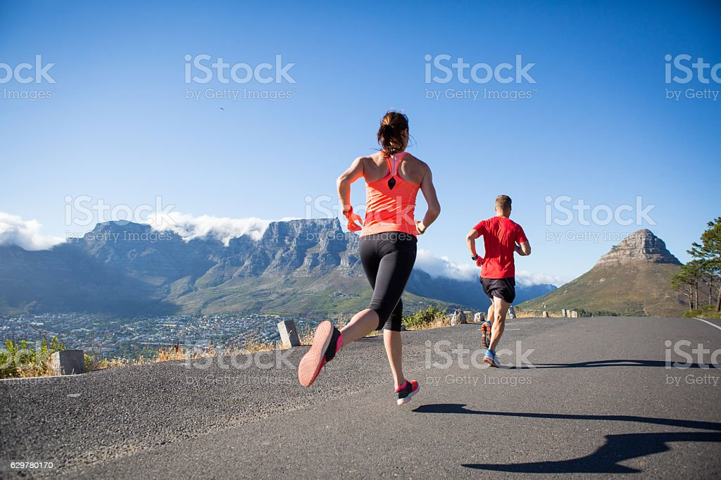 Running together near the mountain stock photo