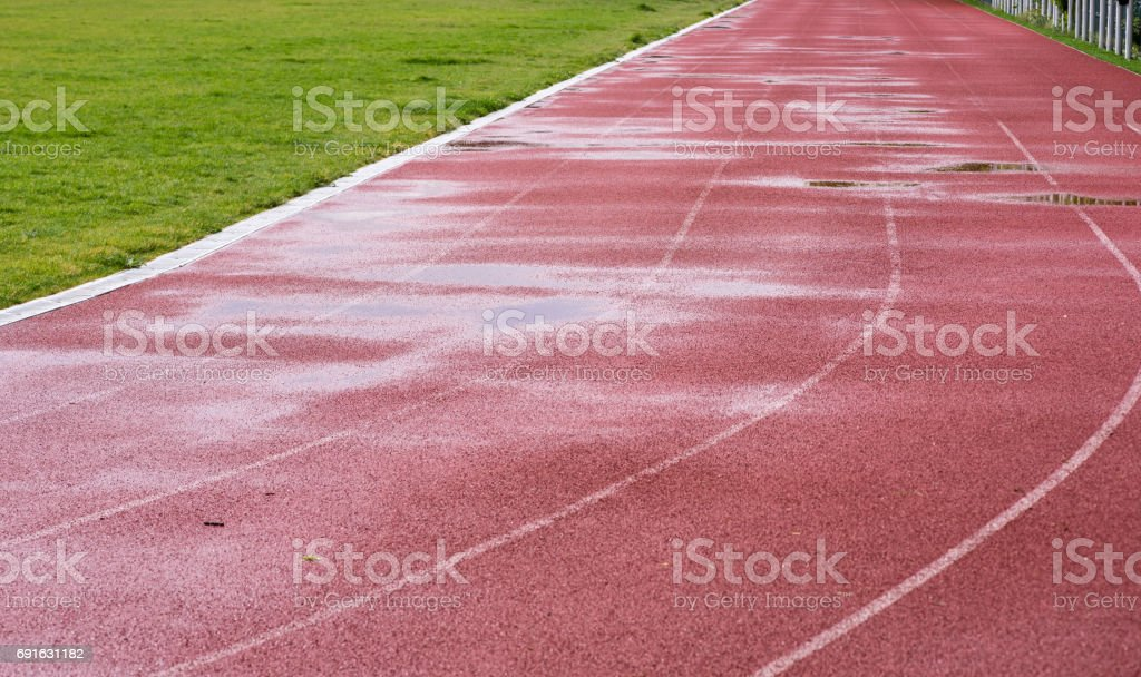 Running track after rain stock photo