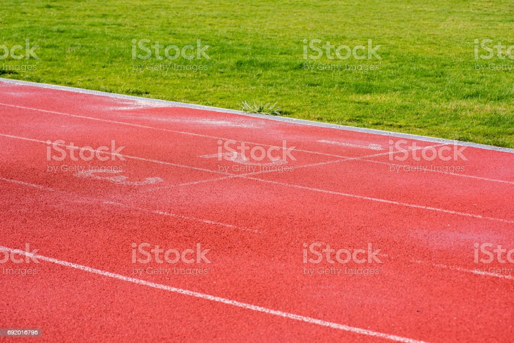 Running track after rain - starting line stock photo