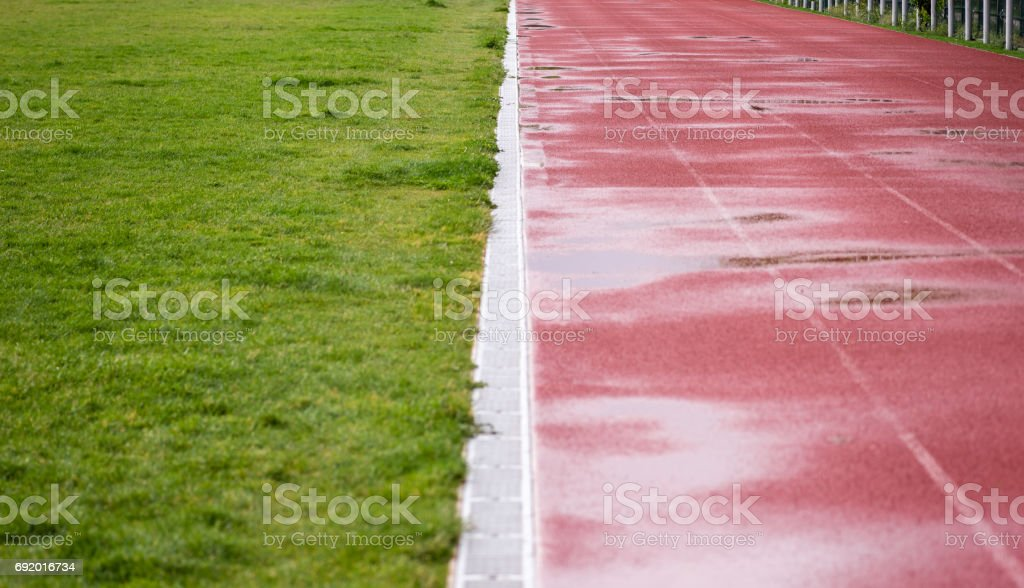 Running track and sports field after rain stock photo