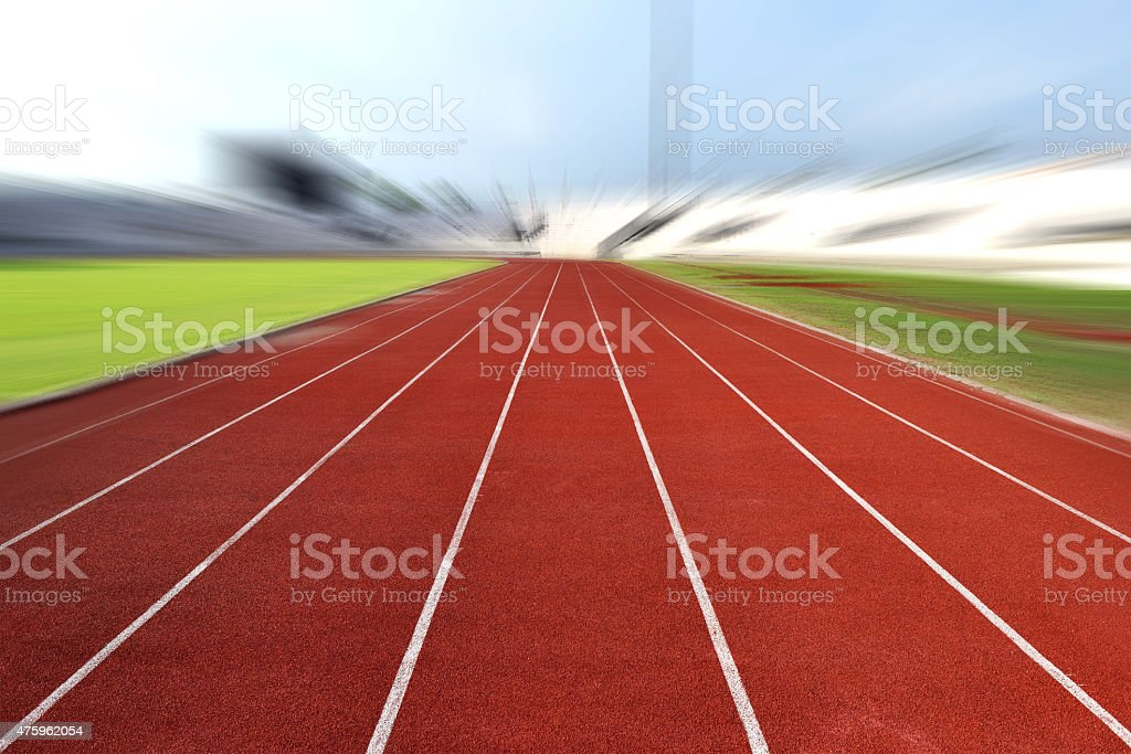 Running Track At A Sport Stadium (radial blur up image) stock photo