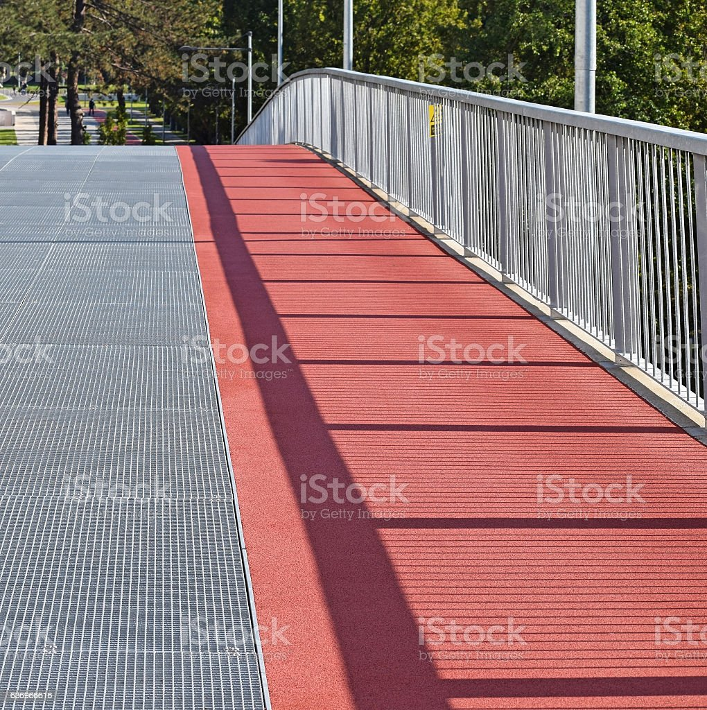 Running track on the pedestrian bridge stock photo