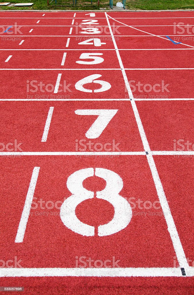 Running track with lane numbers stock photo
