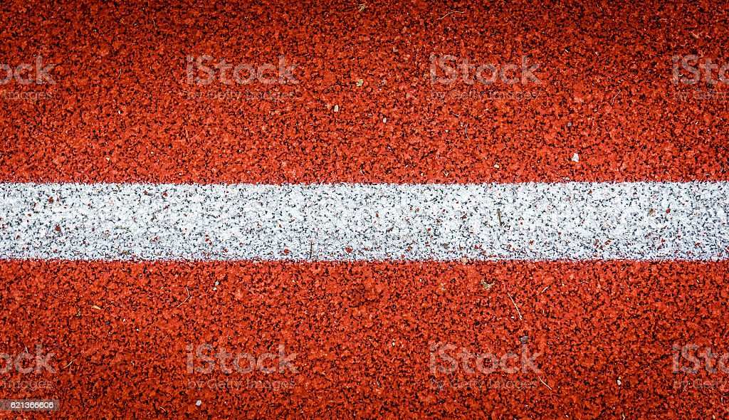Running track with white line rubber texture. Top view rubber stock photo