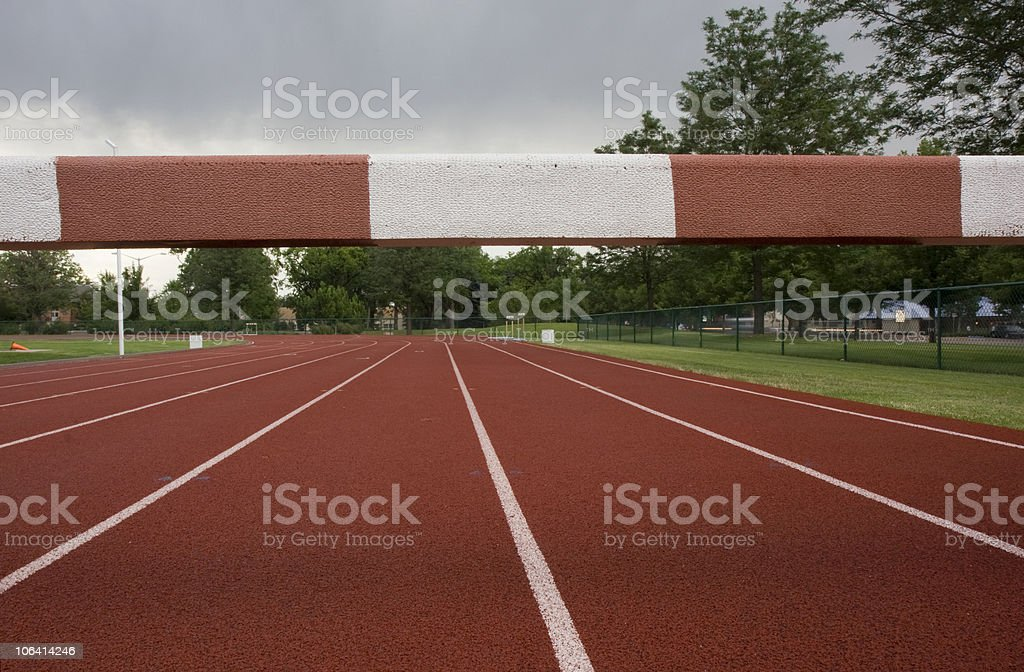 running tracks with a steeplechase  barrier across them stock photo