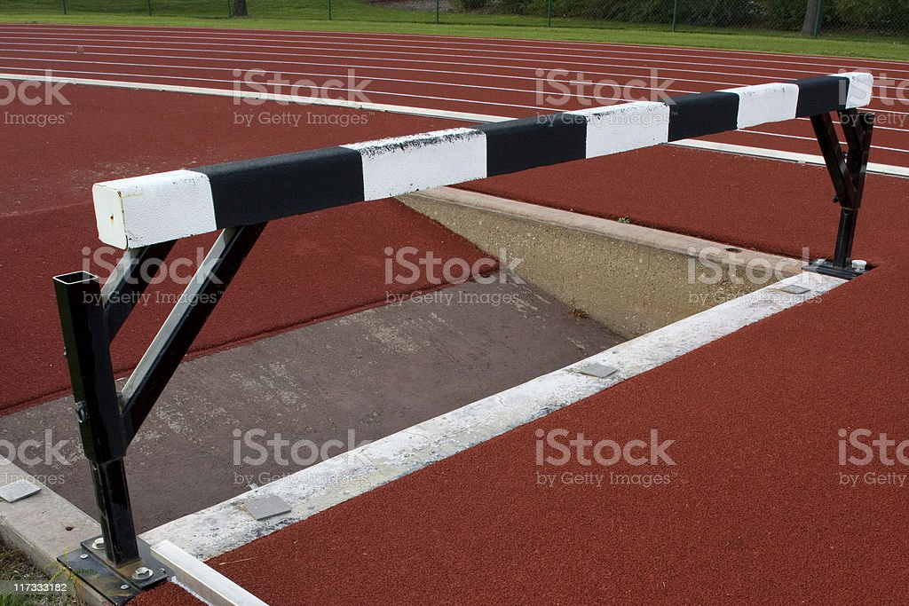 running tracks with steeplechase barrier and water jump royalty-free stock photo