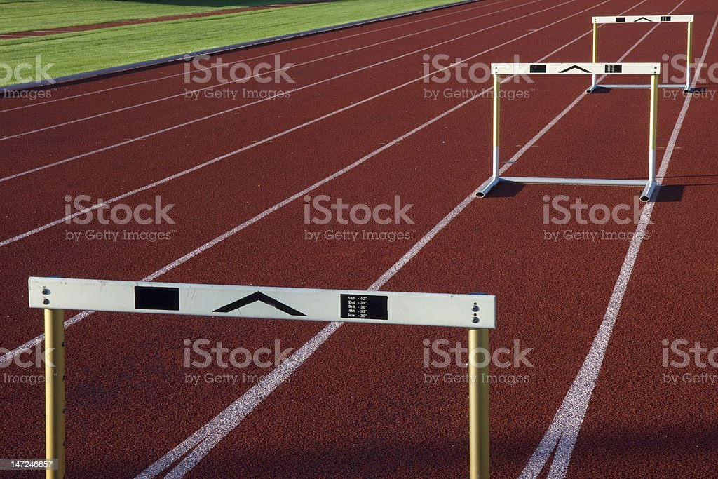 running tracks with three hurdles stock photo