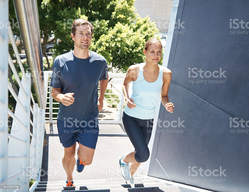 Running up stairs is quite a workout! stock photo