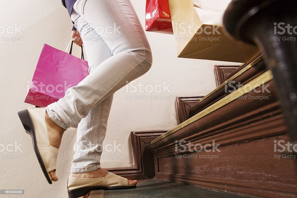 Running up the stairs after shopping stock photo