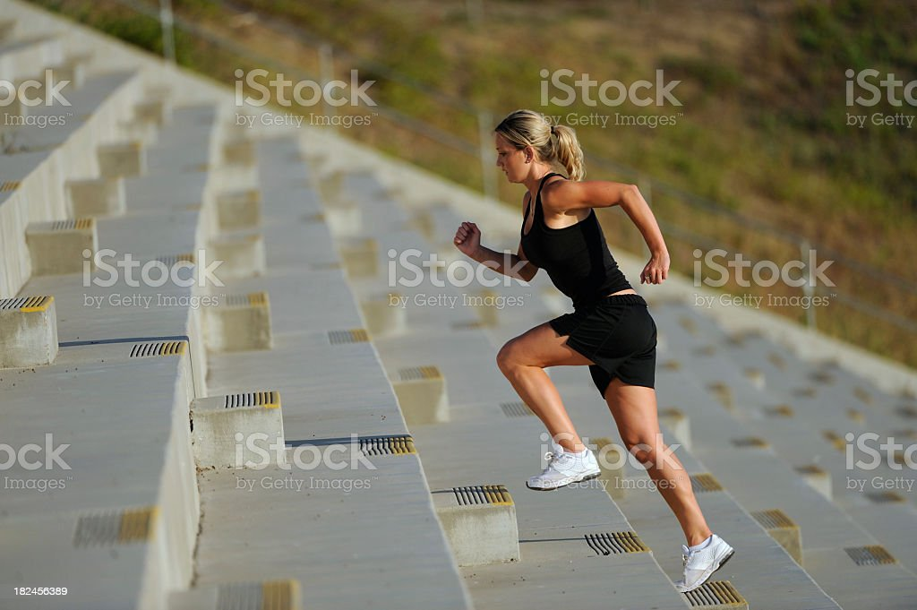 Running up the steps at a stadium royalty-free stock photo