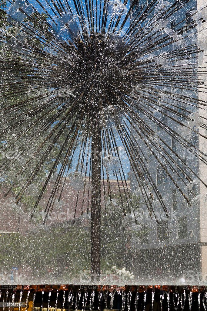 Running water fountain in the shape of a dandelion stock photo