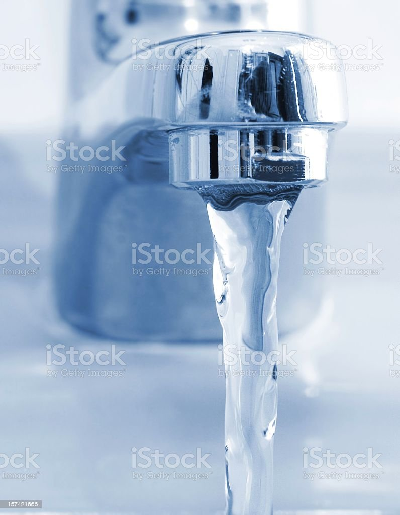 Running water from bathroom faucet royalty-free stock photo