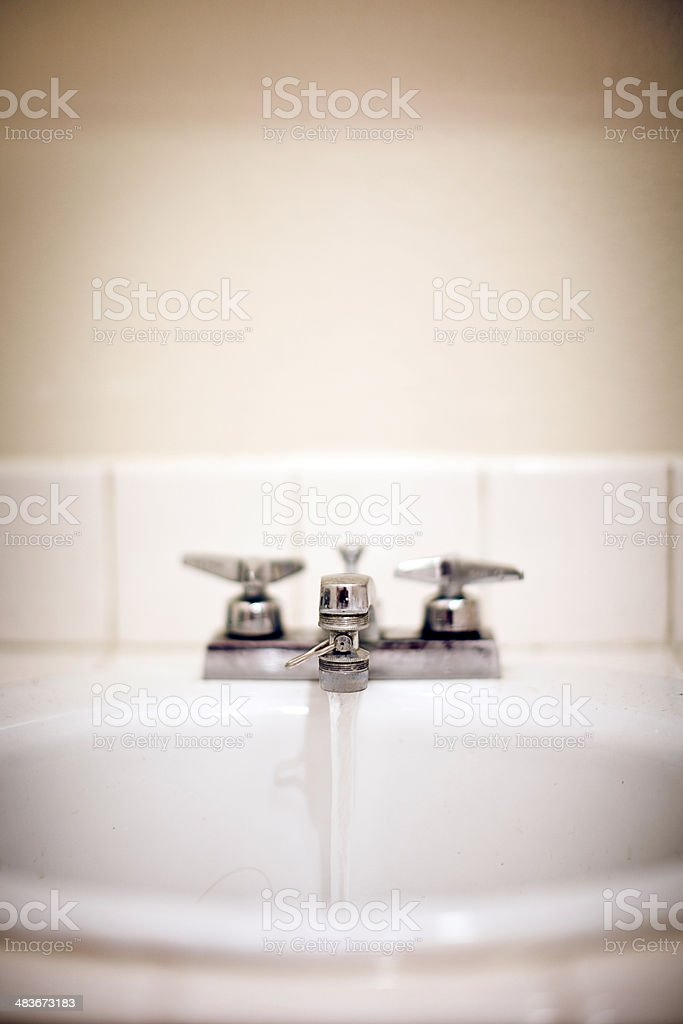 Running Water in Bathroom Sink royalty-free stock photo