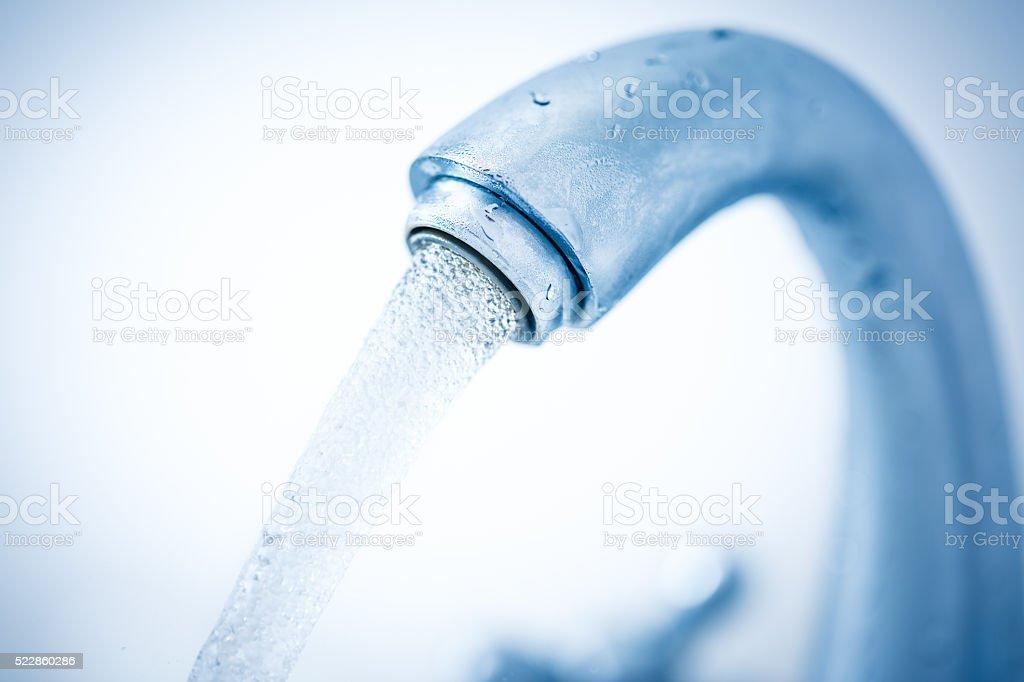 Running water tap closeup stock photo