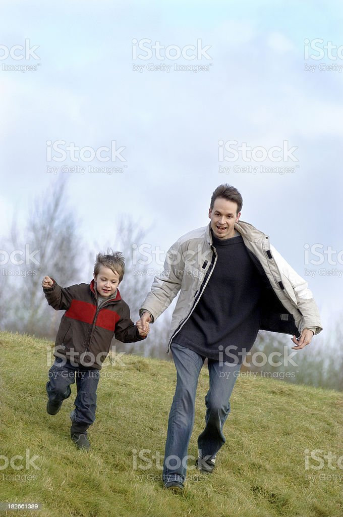 Running with dad stock photo